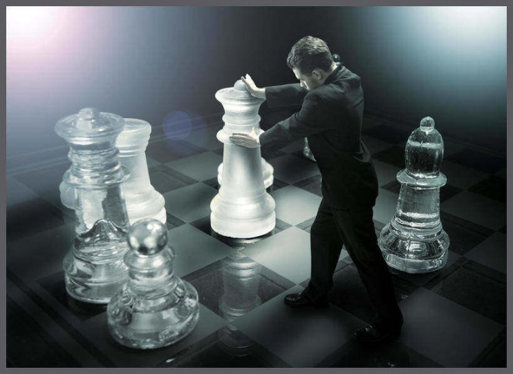Businessman on a chessboard as a dummy