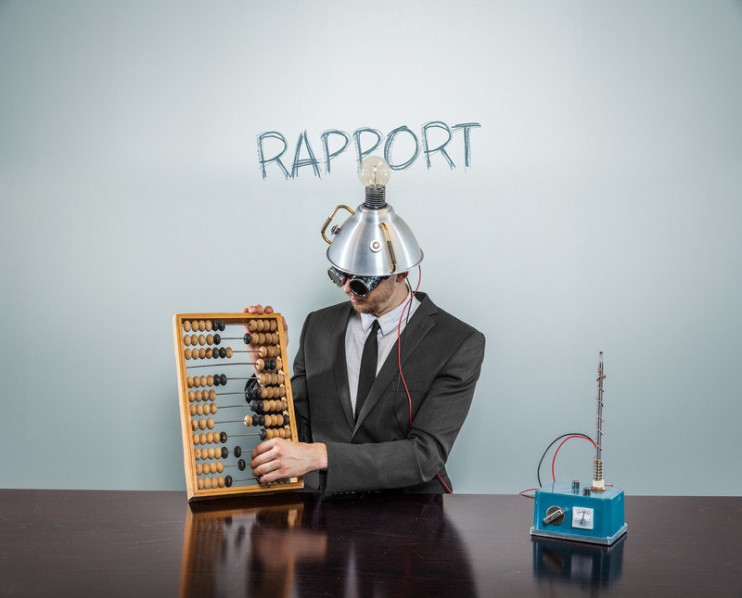 Rapport concept with vintage businessman and calculator at office