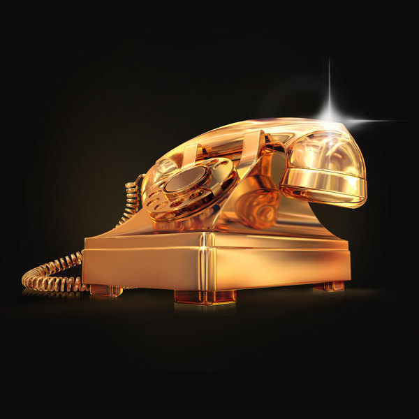 Golden phone on black  background.  High resolution