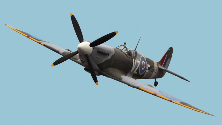 Spitfire isolated sky coloured background with faceless pilot added clipping path included